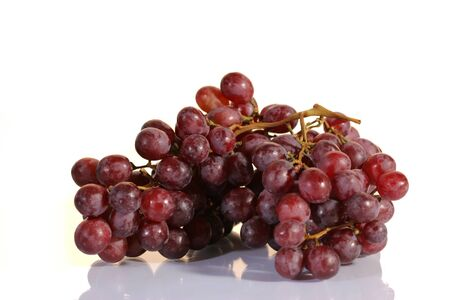 Red grape cluster on a white background photo