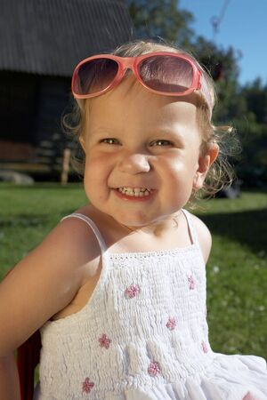 laughing  Cute girl with sunglasses on summer day