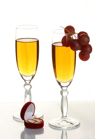 vow: Two glasses with a champagne and wedding rings Stock Photo