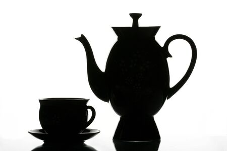 Black cup and teapot on a white background