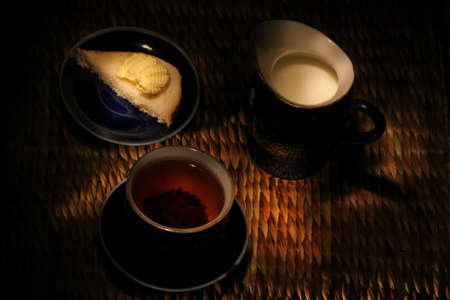 Breakfast: a cup of tea, milk, and roll