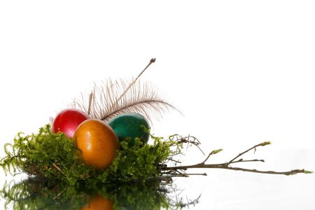 coloured easter eggs in a jack from a moss and branches Stock Photo