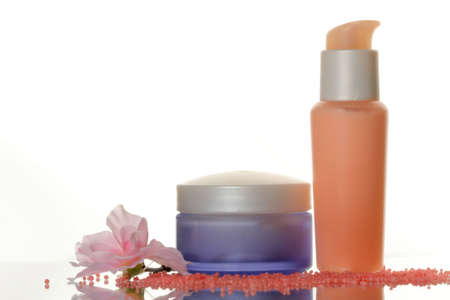Cosmetic set: lotion bottles with cream, salt and flower