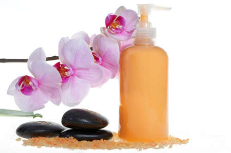 Spa products: orchid, stones, salt and cream