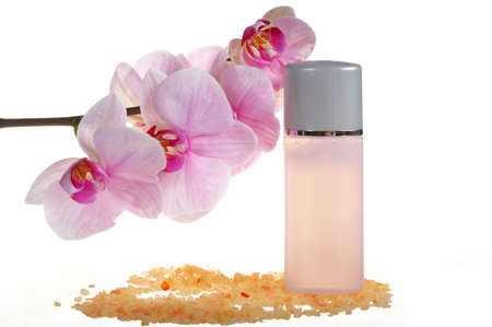 Spa treatment - stones, bottles with cream and orchid Stock Photo