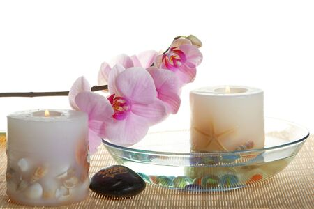 A beautiful orchid, stones and  burning candles Stock Photo