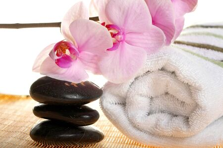 Spa Treatment: stones, towel and orchid
