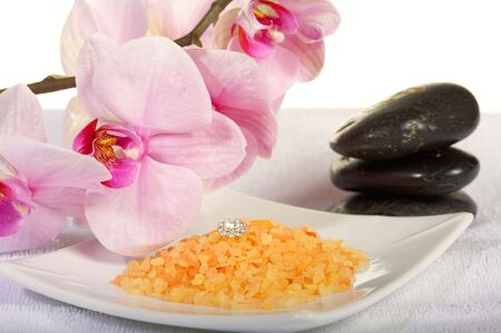 Spa stones with orchid and bath salt Stock Photo