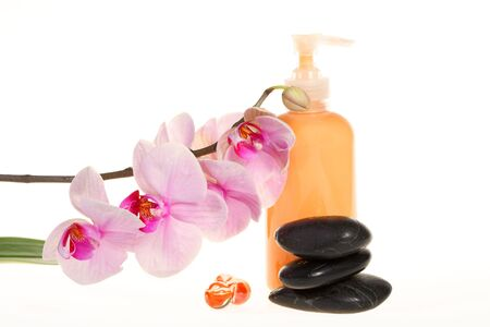 Spa products: stones, cream and orchid