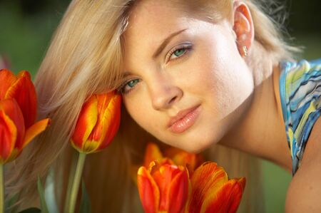 Beautiful girl and red tulips