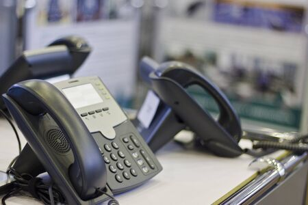Phones on office table after a tough job Standard-Bild