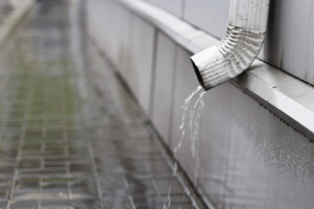 cladding tile: Drainpipe during a heavy rain early in the morning
