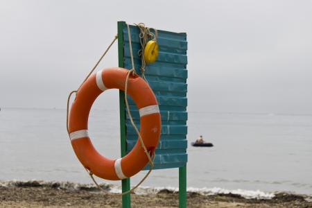 Lifebuoy on a sea beach in the summer photo