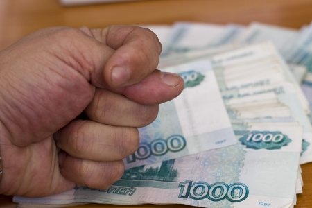 Fig against a big pack of Russian rubles photo