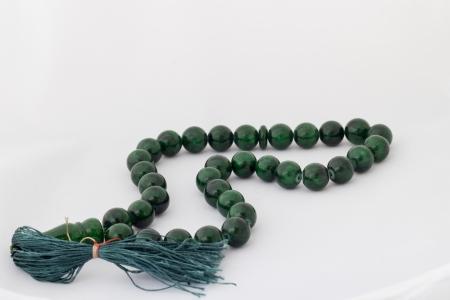 Green malachite beads on a white background Standard-Bild