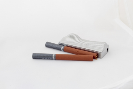 Two cigarets and lighter lie on a white background Stock Photo - 15387178