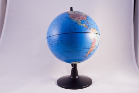 The small globe on a white background photo