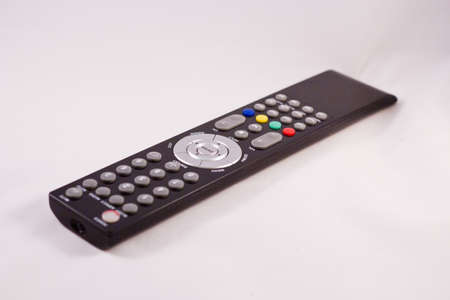 Remote control with multi-colored buttons on a white background photo