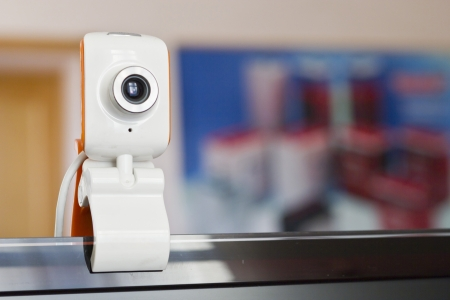 The small webcam hangs on the monitor