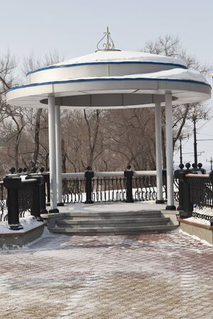 Decorative arbor on the river bank in the winter photo