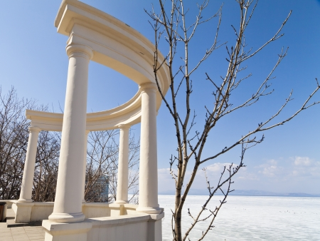 entrance arbor: Stone arbor on the high seashore in the early spring
