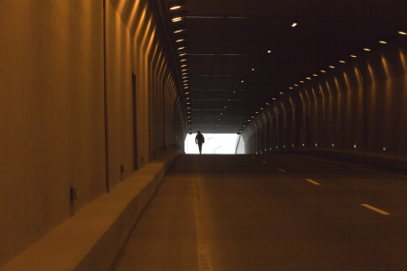 Automobile tunnel without cars with artificial lighting photo