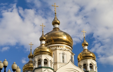 Orthodox church against the blue sky and white clouds photo