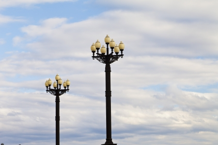 Streetlights against the blue sky and white clouds photo
