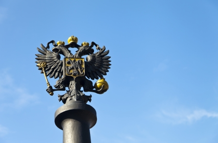 double headed: Two-headed eagle on a stele against the blue sky