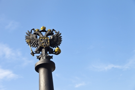 Two-headed eagle on a stele against the blue sky photo