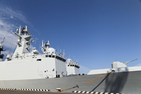 The military ships lie alongside after a long campaign