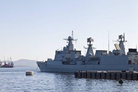 alongside: The military ships lie alongside after a long campaign