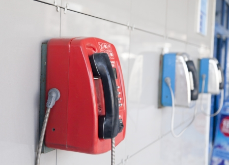 phonebooth: Payphones on a wall waiting for calls and people