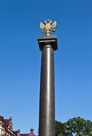 Two-headed eagle on a stele against the bright blue sky Stock Photo - 21496538