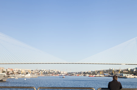 Big suspension bridge in beams of the evening sun photo