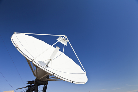 parabolic: The parabolic antenna against the blue sky in the bright sunny day
