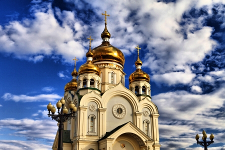 The orthodox temple in the light of a bright sun photo