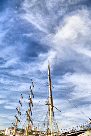 Big sailing vessel against the blue sky in the bright sunny day photo