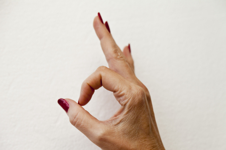 OK from hand fingers on a white background Stock Photo - 23409705