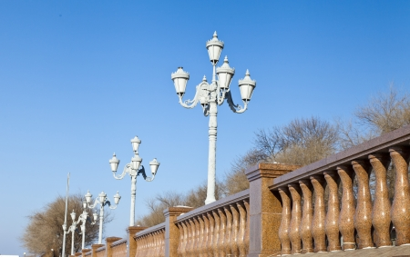 Streetlight in the afternoon in the light of a bright sun photo