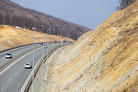 The road among mountains in the bright sunny day photo