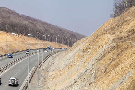 The road among mountains in the bright sunny day