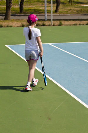The girl on court sits waiting for the rival photo