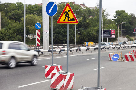 Road signs on a site of construction are expensive Stock Photo