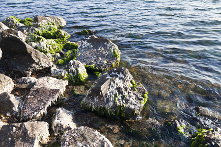 Stones in the water in the surf zone photo