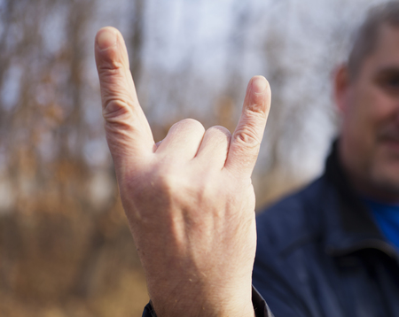 adjusted: Gestures by hands of the man who is adjusted aggressively Stock Photo