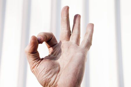 Various gestures by hands performed by different people photo