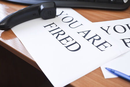 you are fired: Inscription You are fired on the sheet of white paper