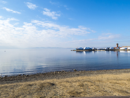 The seashore in the city in sunny autumn day photo