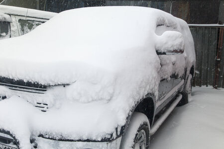 The car costs all in snow and can not go anywhere photo